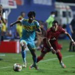 HFC s Akash Mishra dribbles past Luis Machado. (ISL)