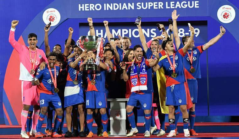 Bengaluru FC players lifting the 2018-19 ISL trophy