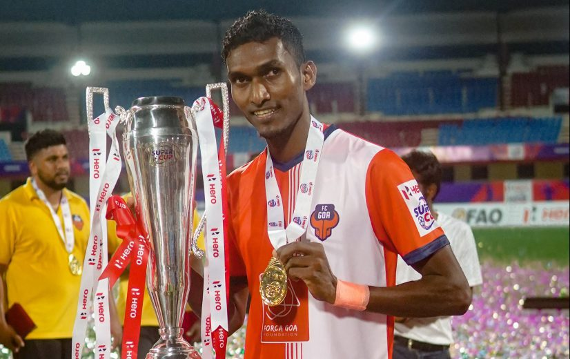 Lenny Rodrigies with the Super Cup Trophy