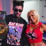 Mandy Rose and Bad Bunny holding the 24/7 belt