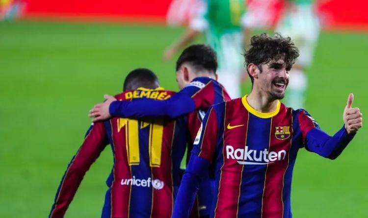 Lionel Messi and Francisco Trincao