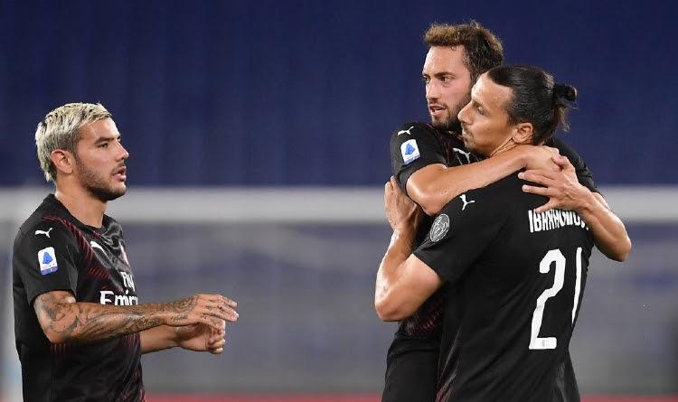 Theo Hernandez, Zlatan Ibrahimovic and Hakan Calhanoglu celebrating the goal